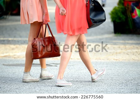 Shopping friends crossing street - stock photo