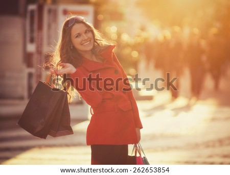 Shopping Girl / Vintage style photo with color filters, vignette effect, and some fine film noise added - stock photo
