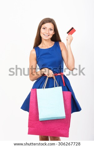 Shopping girl with a credit card - stock photo