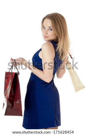 Shopping happy girl with shopping gift bags, against white background.  - stock photo