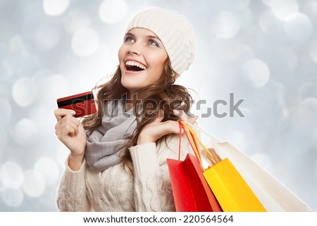 Shopping happy woman holding bags and credit card. Winter sales. - stock photo