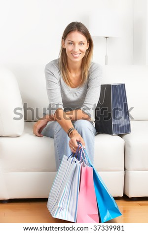Shopping happy  woman sitting on the sofa