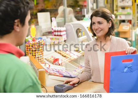 Shopping in a textile market - stock photo