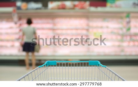 Shopping in supermarket. Shoping cart - stock photo