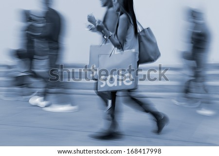 shopping in the city in motion blur and  blue tonality - stock photo