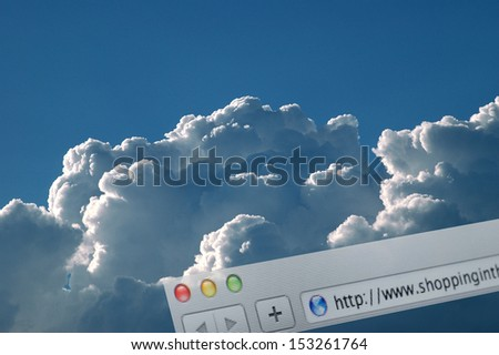 SHOPPING IN THE CLOUD - Browser address line over real clouds - stock photo