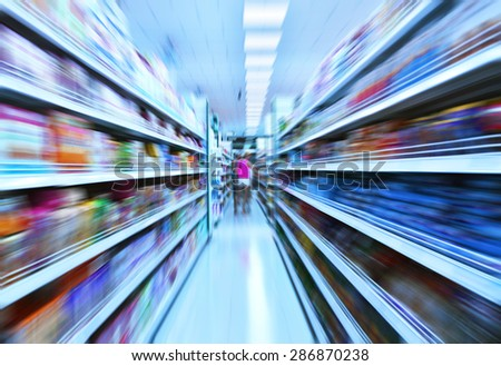 Shopping in the supermarket in motion blur - stock photo