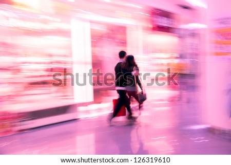shopping lover man and woman walk in marketplace - stock photo