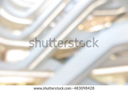 Shopping mall, department store modern luxury interior and escalator blur abstract background