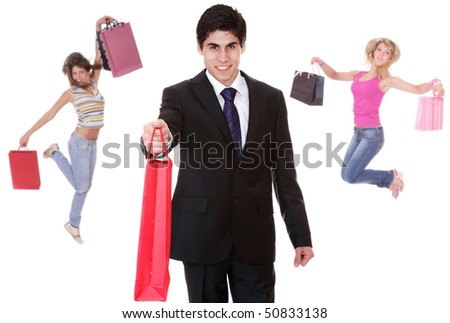 Shopping man with two jumping girls over white background