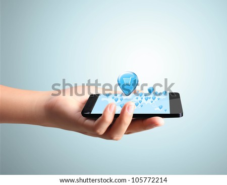 Shopping on Modern mobile phone in hand - stock photo