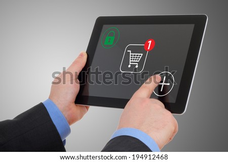 Shopping over the Internet, on your tablet pc - stock photo