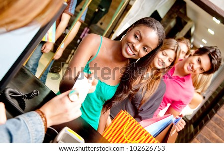 Shopping people at a store queuing to pay