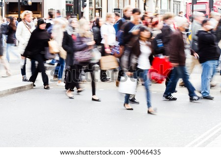 shopping people crossing a street in London - stock photo