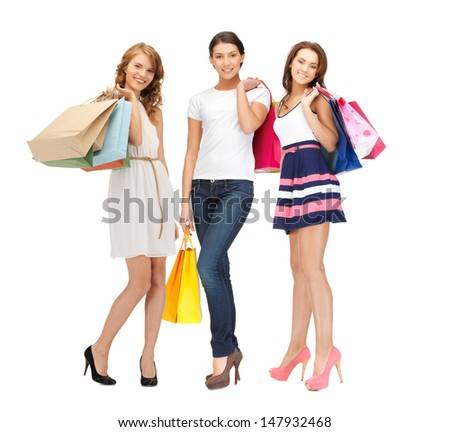 shopping, presents and gifts - attractive girls holding color shopping bags - stock photo