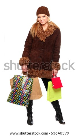 Shopping pretty woman dressed in winter clothing - studio shot on white background