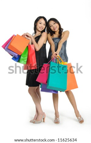 Shopping pretty woman with colored package - stock photo