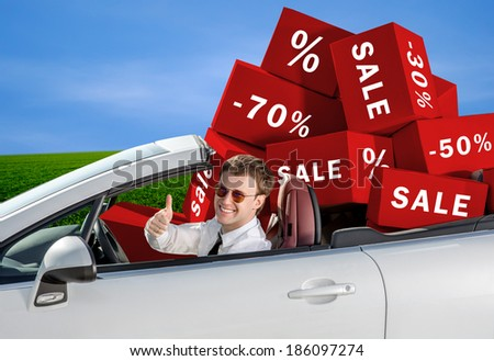 shopping, sale and gift sconcept, man in the car with boxes - stock photo