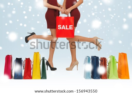 shopping, sale, gifts, christmas, x-mas concept - woman's long legs with shopping bags and shoes - stock photo
