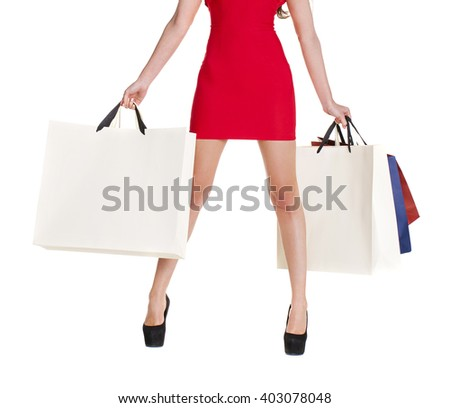 Shopping. Sexy female legs and color bags, isolated on white background - stock photo