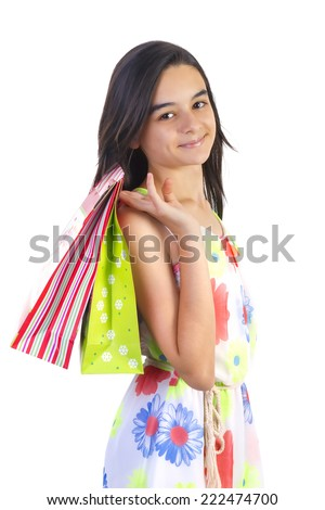 Shopping teenager girl smiling and holding shopping bags. Closeup portrait of beautiful young girl. - stock photo