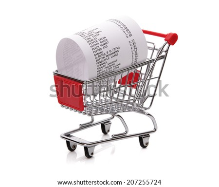Shopping till receipt in cart concept for grocery expenses and consumerism - stock photo