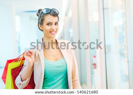 Shopping time, attractive woman at mall - stock photo