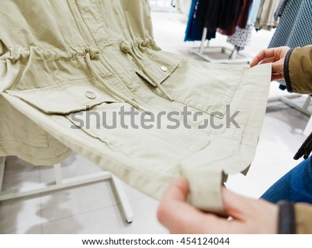 Shopping time concept. Part body buyer customer client wathing touching clothes in botique shop market. - stock photo