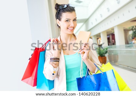 Shopping time, woman at mall - stock photo