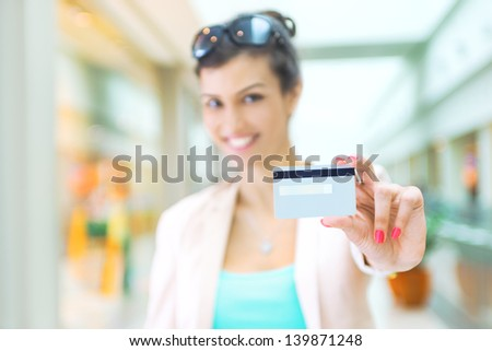 Shopping time, woman at mall, focus on credit card - stock photo