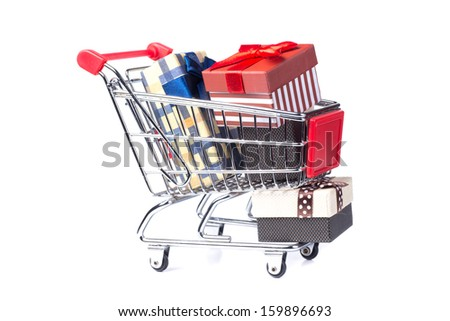 Shopping trolley full of Christmas presents. Christmassy gifts.