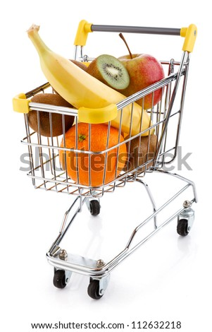 Shopping trolley full of fruits on white background - stock photo