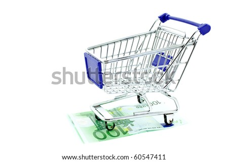 shopping trolley on 100 euro notes isolated on white background