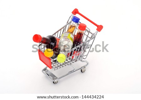 Shopping trolley with alcohol bottles - stock photo