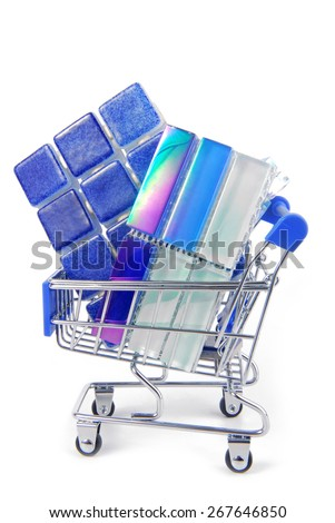 shopping trolley with ceramic tiles - stock photo