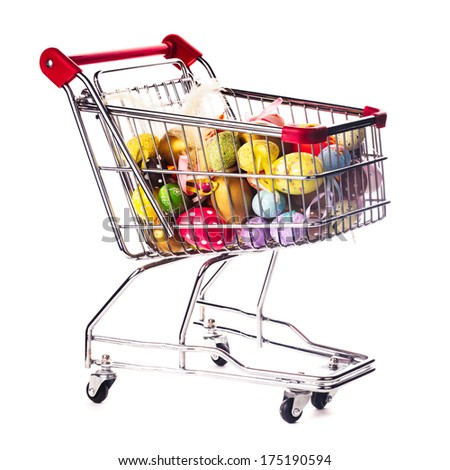 Shopping trolley with many decorative easter eggs on white