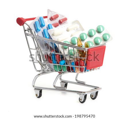 Shopping trolley with pills and medicine - stock photo