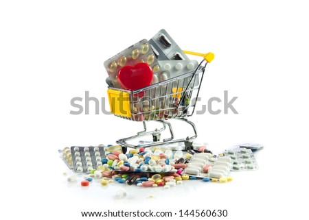 shopping trolley with pills,heart  isolated on white background