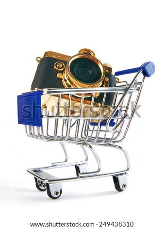 Shopping trolley with retro camera isolated on white background - stock photo