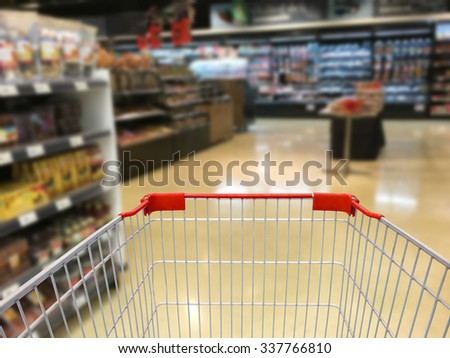 Shopping with Cart View in Supermarket blurred background - stock photo