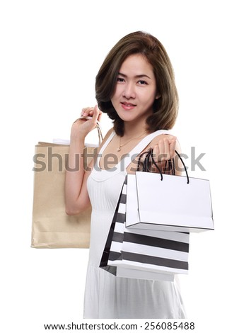 Shopping woman asian happy smiling holding shopping bags isolated on white background. Lovely fresh young Asian female model.