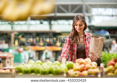 shopping woman buying fruit at the market
