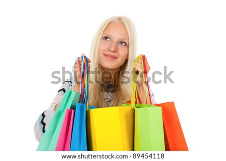 shopping woman happy excited smiling holding bags, looking up to empty copy space, wear winter knitted sweater, isolated over white background isolated on white background. - stock photo