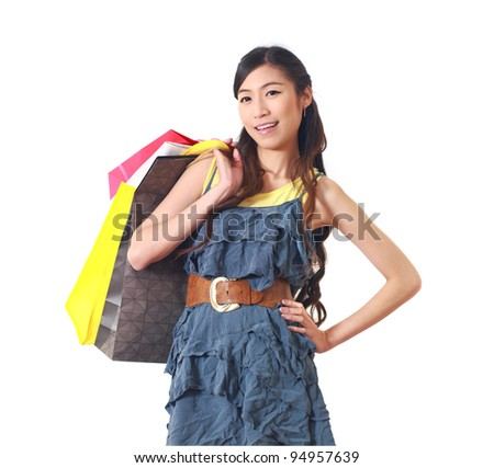 Shopping woman happy smiling holding shopping bags on white background. - stock photo