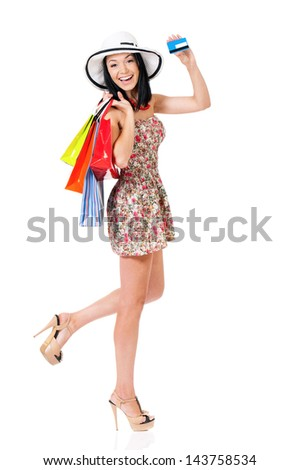 Shopping woman happy smiling holding shopping bags showing credit card or gift card, isolated on white background - stock photo