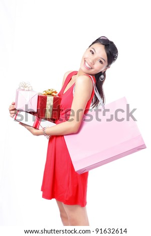 Shopping woman happy take big shopping bag and gift isolated on white background, model is a asian beauty - stock photo