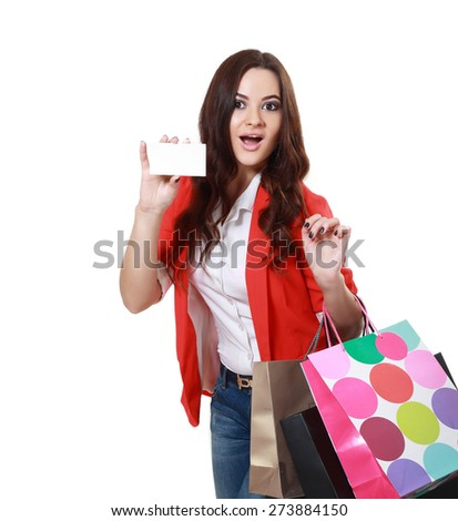 Shopping woman hold a blank card shopping bags - isolated over white - stock photo