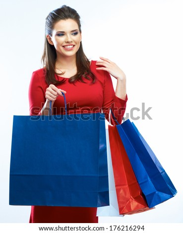 Shopping woman hold bags, portrait isolated. White background. Happy shopping girl. Red dress. female beautiful model. - stock photo