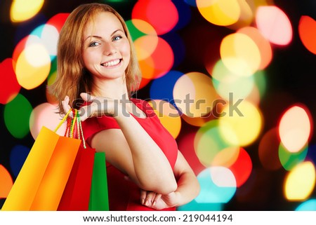 Shopping woman holding bags. isolated on gray studio background - stock photo