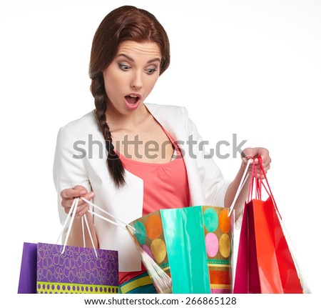 Shopping woman holding bags, isolated on white studio background. - stock photo